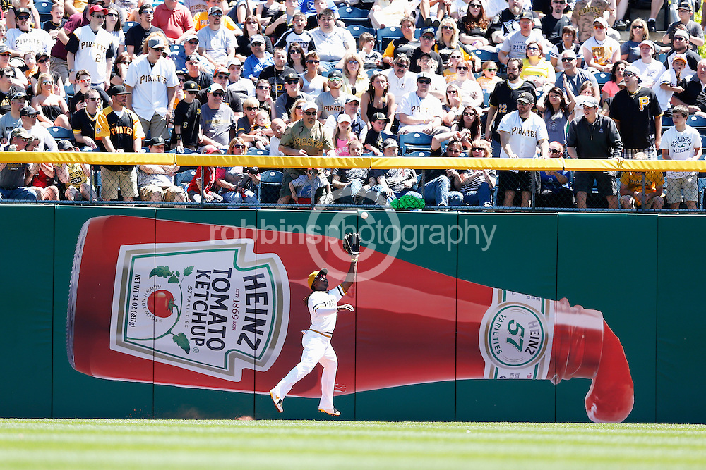 PITTSBURGH, PA - MAY 5: Andrew McCutchen #22 of the Pittsburgh Pirates makes a catch in front of a Heinz Ketchup advertisement on the outfield wall during the game against the Washington Nationals at PNC Park on May 5, 2013 in Pittsburgh, Pennsylvania. The Nationals won 6-2. (Photo by Joe Robbins)  Andrew McCutchen