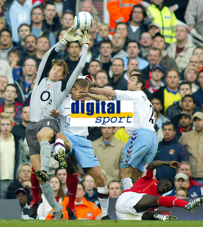 16/10/2004<br />FA Barclays Premiership - Arsenal v Aston Villa - HIghbury<br />Arsenal's Jens Lehmann just manages to get finger tips to the ball as Aston Villa's Olof Mellberg and Mark Delaney (r) try to disposses him and Arsenal's Kolo Toure lands on the turf.<br />Photo:Jed Leicester/BPI (back page images)