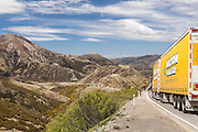 A truck travelling along West Coast Road SH73 dropping down towards the Canterbury plains, South Island, New Zealand