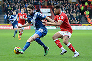 Bristol City defender Scott Golbourne holds up Birmingham City midfielder Will Buckley during the Sky Bet Championship match between Bristol City and Birmingham City at Ashton Gate, Bristol, England on 30 January 2016. Photo by Alan Franklin.