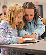 Jaydon Lindley (from left) and Belle Miller, both 8 years old, look over their new dictionary during the dictionary giveaway by Cedar Rapids Elks Lodge #251 at Prairie Crest Elementary School in Cedar Rapids on Monday, November 5, 2012. Both Lindley and Miller are in Amy Dieters' third grade glass.