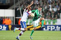 FOOTBALL - FRENCH LEAGUE CUP 2011/2012 - 1/8 FINAL - AS SAINT ETIENNE v OLYMPIQUE LYONNAIS - 26/10/2011 - PHOTO EDDY LEMAISTRE / DPPI - JIMMY BRIAND (OL) AND LORIS NERY (ASSE)
