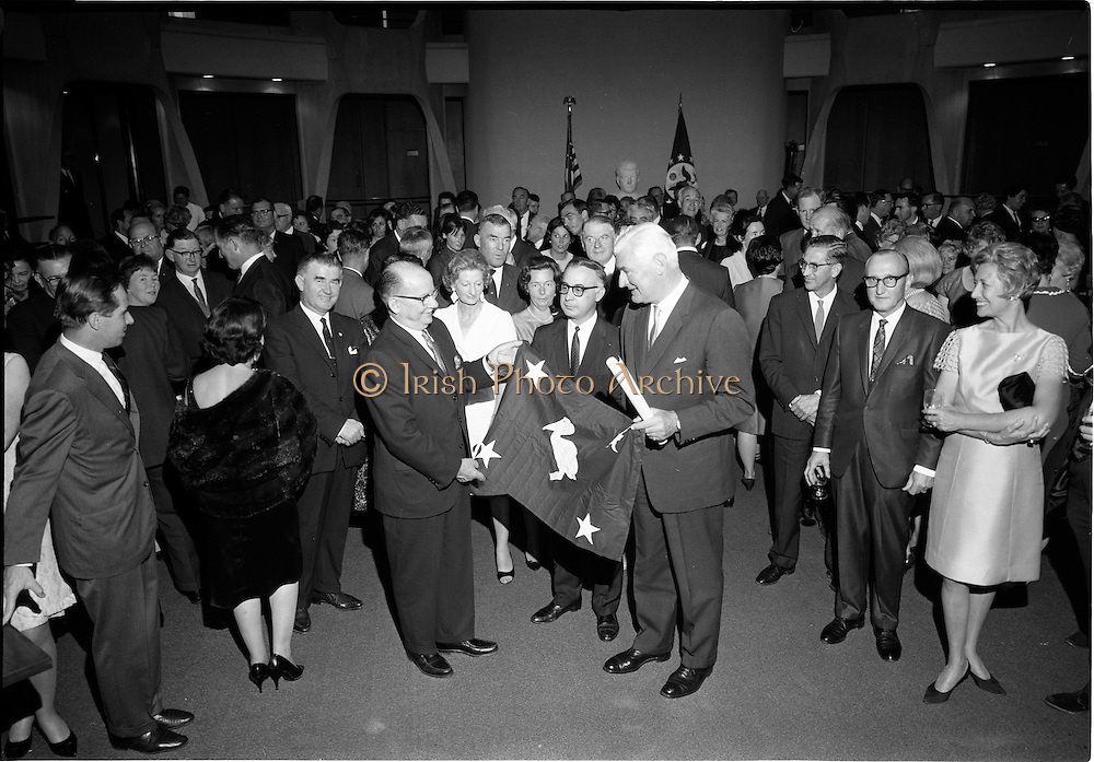 18/09/1967<br /> 09/18/1967<br /> 18 September 1967<br /> Mr Paul A. Fabry, Managing Director, International House, New Orleans, Reception for New Orleans Delegation at the United States Embassy, Dublin. Image shows Thomas Q. Winkler, Vice President of International House and President, Winkler and Co. (Insurance) presenting U.S. Ambassador Raymond Richard Guest with a flag from Louisiana.