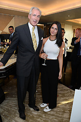 An exclusive preview of the new Samsung OLED Curved TV has hosted by Nick & Holly Candy at their home at One Hyde Park, London on 29th August 2013.<br /> Picture shows:-Jeremy King and his daughter Margot