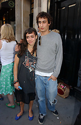 LOLA HOBBS and ALEX DELLAL at an exhibition of photographs by David Montgomery entitled 'Shutterbug' held at Scream, 34 Bruton Street, London W1 on 13th July 2006.<br /><br />NON EXCLUSIVE - WORLD RIGHTS