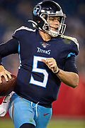 NASHVILLE, TN - AUGUST 17:  Logan Woodside #5 of the Tennessee Titans runs the ball during a game against the New England Patriots during week two of the preseason at Nissan Stadium on August 17, 2019 in Nashville, Tennessee.  The Patriots defeated the Titans 22-17.  (Photo by Wesley Hitt/Getty Images) *** Local Caption *** Logan Woodside