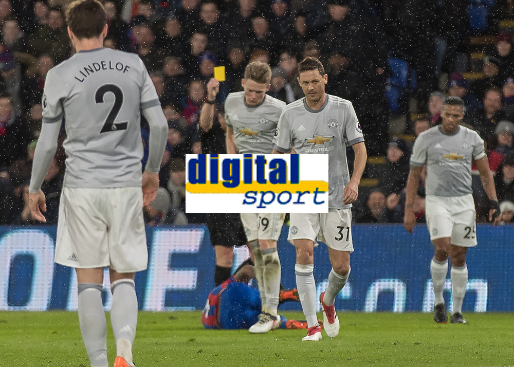 Football - 2017 / 2018 Premier League - Crystal Palace vs. Manchester United<br /> <br /> Nemanja Matic (Manchester United) walks away after receiving a yellow card <br /> at Selhurst Park.<br /> <br /> COLORSPORT/DANIEL BEARHAM