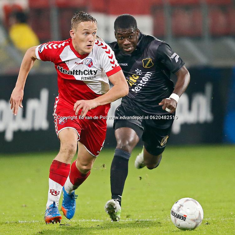 UTRECHT, 19-10-2013, eredivisie, FC Utrecht - NAC Breda, Galgenwaard Stadion, 4-2, FC Utrecht speler Jens Toornstra (l), Speler van NAC Jeffrey Sarpong (r).