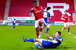 Tony Craig of Bristol Rovers slides in to stop an attack by Chiedozie Ogbene of Rotherham United - Mandatory by-line: Ryan Crockett/JMP - 18/01/2020 - FOOTBALL - Aesseal New York Stadium - Rotherham, England - Rotherham United v Bristol Rovers - Sky Bet League One