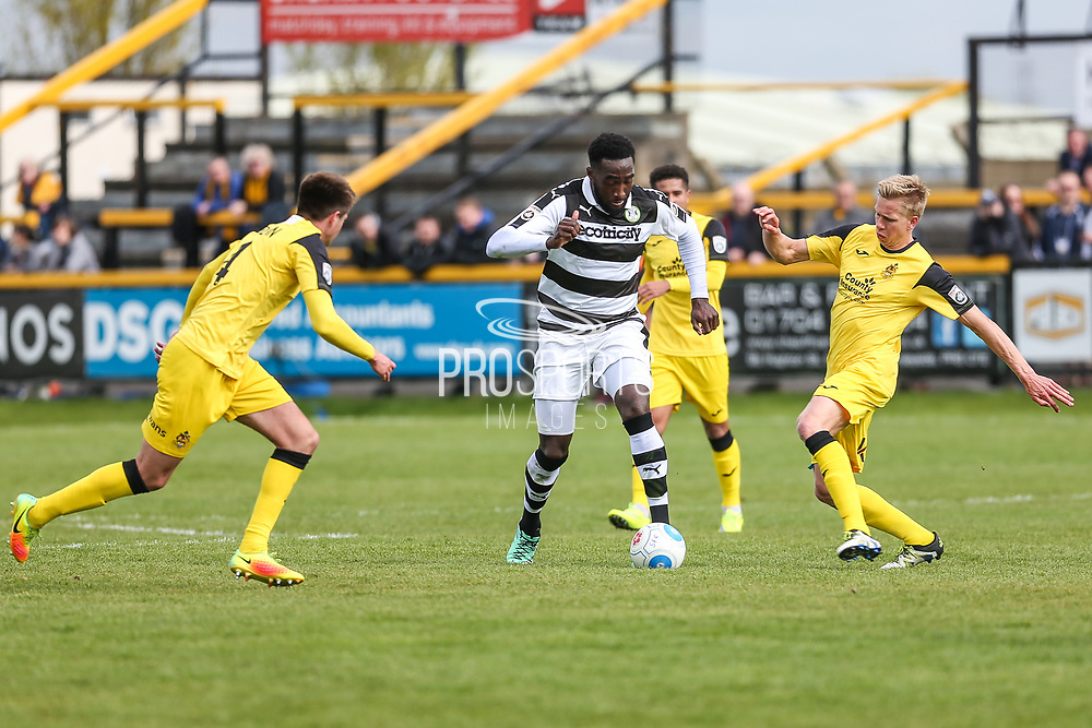 Forest Green Rovers Manny Monthe(3) runs forward during the Vanarama National League match between Southport and Forest Green Rovers at the Merseyrail Community Stadium, Southport, United Kingdom on 17 April 2017. Photo by Shane Healey.