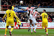 Mathieu Manset heads at goal during the Sky Bet League 2 match between Cheltenham Town and Plymouth Argyle at Whaddon Road, Cheltenham, England on 28 March 2015. Photo by Alan Franklin.