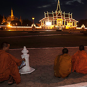 Cambodian mourners and Buddhist Monks gather outside the Royal Assembly near the Mekong River in Phnom Penh, Saturday, Feb. 2, 2012, to offer prayers for former King Norodom Sihanouk who passed away in Beijing, China on Oct. 15, 2012.  Cremation ceremonies for Sihanouk are set of Feb. 4, 2013 in Phnom Penh.