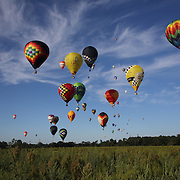 Hot Air balloons in the skies around rural Michigan near Battle Creek during the World Hot Air Ballooning Championships. Battle Creek, Michigan, USA. 18th August 2012. Photo Tim Clayton