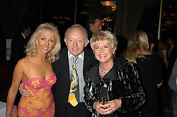 Magician PAUL DANIELS, his wife DEBBIE McGEE and GLORIA HUNNIFORD at a party to celebrate the publication of 'Next To You' - Caron's Courage remembered by her mother Gloria Hunniford held on Caron's birthday at The Hilton Park Lane, London on 5th Octobe 2005.<br />