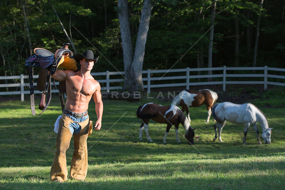rugged shirtless cowboy without a shirt on a ranch