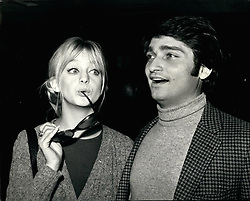 "Jan. 29, 1970 - January 29th, 1970 Goldie Hawn arrives – Goldie Hawn, the kooky blonde of the American TV show, The Rowan and Martin Laugh-in seen on British TV, arrived at Heathrow Airport today. Tonight she will be one of the leading guests at the premiere in London's West End, of the film ""Marooned"", which stars Gregory Peck. Goldie has made her first film ""Cactus Flower"", and her second ""There's a Girl in My Soup"" will be made in Britain. Photo Shows: Goldie Hawn pictured on her arrival at Heathrow Airport, with her husband, Gus Trekonis. (Credit Image: © Keystone Press Agency/Keystone USA via ZUMAPRESS.com)"