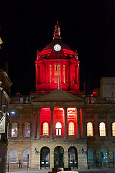LIVERPOOL, ENGLAND - Tuesday, April 26, 2016: Liverpool City Council illuminate the Town Hall on Water Street in red and stop the clock at 3:06 and lower the flag to half-mast in tribute those who lost their lives in the Hillsborough Disaster on the 15 April 1989. This is to mark the verdicts in the two year inquest that returned a verdict of Unlawful Killing. (Pic by David Rawcliffe/Propaganda)