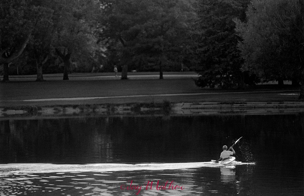 A kayaker glides across Washington Park Lake, 1975.