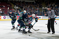 KELOWNA, CANADA - JANUARY 30:  Graeme Bryks #37 of the Seattle Thunderbirds is checked by Kyle Crosbie #25 of the Kelowna Rockets after the face off on January 30, 2019 at Prospera Place in Kelowna, British Columbia, Canada.  (Photo by Marissa Baecker/Shoot the Breeze)