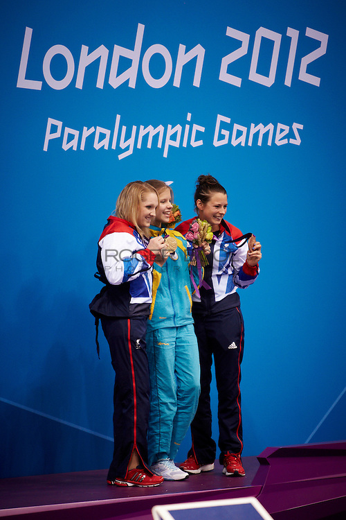 L-R Charlotte Henshaw of Great Britain and Viktoriia Savsova of the Ukraine and Elizabeth Johnson of Great Britain in the women's 100 meter breaststroke SB6 medal Ceremony at the Aquatics Centre on day 7 of the London 2012 Paralympic Games. 5th September 2012.