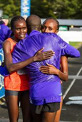 Daniel Salel congratulates runner-up Cynthia Limo and Mary Wacera