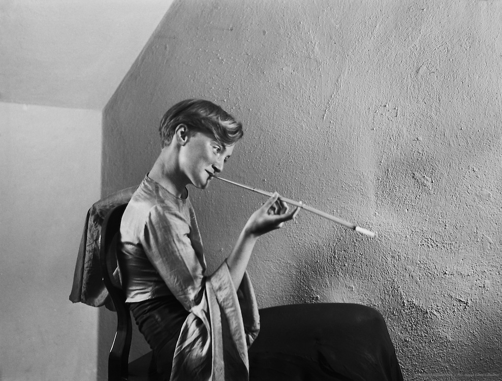 Woman sitting on the chair and smoking, long cigarette holder, Austria, 1934