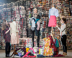 Students Lucu Morrant and Hannah McKinnon with model Anna Freemantle, showing fashion students about upcycling clothes, at the UK&rsquo;s second largest textile recycling facility, Nathan&rsquo;s Wastesavers, in Denny.<br /> &copy; Michael Schofield.