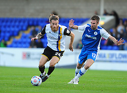 Bristol Rovers' Stuart Sinclair is challenged by Chester's Josh O'Keefe - Photo mandatory by-line: Neil Brookman/JMP - Mobile: 07966 386802 - 22/11/2014 - Sport - Football - Chester - Deva Stadium - Chester v Bristol Rovers - Vanarama Football Conference