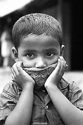 BANGLADESH COX'S BAZAAR DISICT RAMU OCT94 - A Muslim boy holds a cap in front of his mouth...The Bangladesh Bureau of Statistics estimates the total working child population between 5 and 17 years old to be at 7.9 million...jre/Photo by Jiri Rezac..© Jiri Rezac 1994