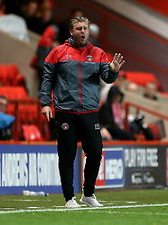 Charlton Athletic manager Karl Robinson gestures on the touchline