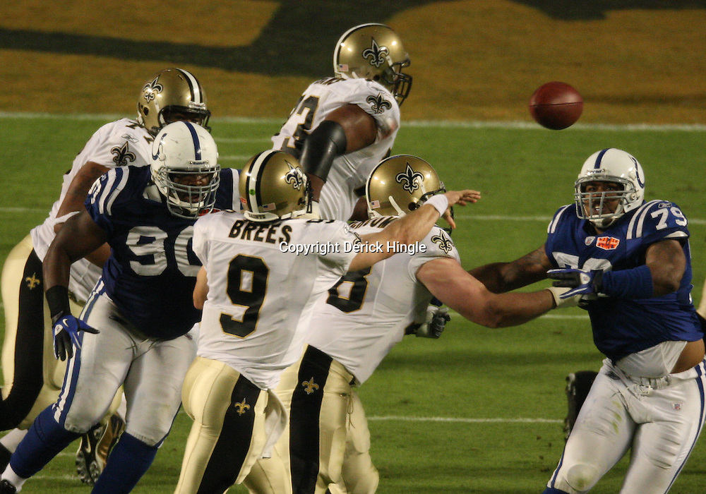 2010 February 07: New Orleans Saints quarterback Drew Brees (9) throws as Indianapolis Colts defensive tackle Daniel Muir (90) and defensive tackle Raheem Brock (79) provide pressure during a 31-17 win by the New Orleans Saints over the Indianapolis Colts in Super Bowl XLIV at Sun Life Stadium in Miami Gardens, Florida.