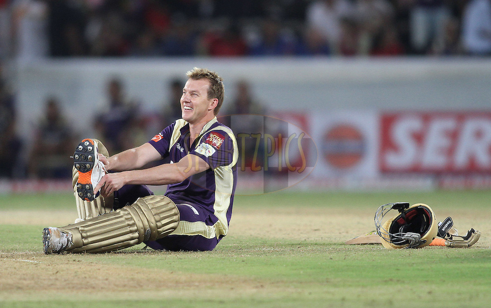Brett Lee of the Kolkata Knight Riders put his boot back on during the CLT20 - Q6 match between Kolkata Knight Riders and Somerset held at the Rajiv Gandhi International Stadium, Hyderabad on the 21st September 2011..Photo by Shaun Roy/BCCI/SPORTZPICS