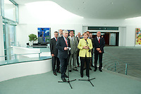 28 AUG 2009, BERLIN/GERMANY:<br /> Michael Sommer (L), Vorsitzender Deutscher Gewerkschaftsbund, Angela Merkel (R), CDU, Bundeskanzlerin, und Hubertus Schmoldt, Vorsitzender Industriegewerkschaft Bergbau, Chemie, Energie, Konrad Freiberg, Vorsitzender Gewerkschaft der Polizei, Frank Bsirske, Vorsitzender ver.di, Berthold Huber, Vorsitzender IG Metall, (2. Reihe v.L.n.R.), waehrend einem Pressestatement, vor einem Gespraech der Bundeskanzlerin mit den Vorsitzenden der Gewerkschaften, Skylobby, Bundeskanzleramt<br /> IMAGE: 20090828-01-013