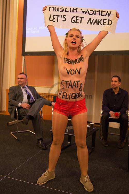Berlin, Germany - 20.03.2014<br /> <br /> FEMEN activists disturb a panel discussion of the Islamic-Week in the Red City Hall in Berlin. The protest is directed against the panel member Dr. Mustafa Yoldas, who is active in the Islamic Community of Milli G&ouml;r&uuml;s and former chairman of the International Humanitarian Aid Organization IHH. The IHH was banned in 2010 for donating more than 6 million euros to the radical Islamic Hamas. The police ended the FEMEN protest.<br /> <br /> FEMEN-Aktivistinnen st&uuml;rmen eine Podiumsdiskussion der Islamwoche im Roten Rathaus in Berlin. Der Protest richtet sich gegen den Podiumsteilnehmer Dr. Mustafa Yoldas, der in der Islamischen Gemeinschaft Milli G&ouml;r&uuml;s aktiv ist und Vorsitzender der Internationalen Humanit&auml;ren Hilfsorganisation IHH war. Die IHH wurde im 2010 verboten da sie mehr als 6 Millionen Euro an die radikalislamische Hamas gespendet haben soll. Die Polizei beendete die FEMEN Protestaktion.<br /> <br /> Photo: Bjoern Kietzmann