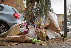 © Licensed to London News Pictures. 21/04/2018. London, UK. Floral tributes are left on the pavement near Morden Underground, south London where a man died following an assault. Police were called by the London Ambulance Service at 22:17hrs on Thursday, 19 April, after ambulance staff suspected that a man collapsed on London Road in Morden had been assaulted. The 32-year-old man was taken to a south London hospital in a critical condition. He died at 23:45hrs on Friday, 20 April. His next of kin have been informed. Photo credit: Peter Macdiarmid/LNP