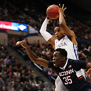 James Woodard, Tulsa, rebounds over Amida Brimah, UConn, during the UConn Huskies Vs Tulsa Semi Final game at the American Athletic Conference Men's College Basketball Championships 2015 at the XL Center, Hartford, Connecticut, USA. 14th March 2015. Photo Tim Clayton