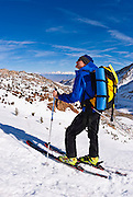 Backcountry skier on the road to North Lake, Inyo National Forest, Sierra Nevada Mountains, California