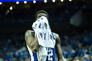19 MAR 2015: Dionte Adams (32) of Hampton wipes down during a timeout as the Pirates take on University of Kentucky during the 2015 NCAA Men's Basketball Tournament held at the KFC Yum! Center in Louisville, KY. Kentucky defeated Hampton 79-56. Brett Wilhelm/NCAA Photos