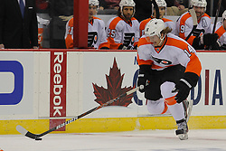 Jan 22, 2013; Newark, NJ, USA; Philadelphia Flyers center Sean Couturier (14) skates with the puck during the third period of their game against the New Jersey Devils at the Prudential Center. The Devils defeated the Flyers 3-0.