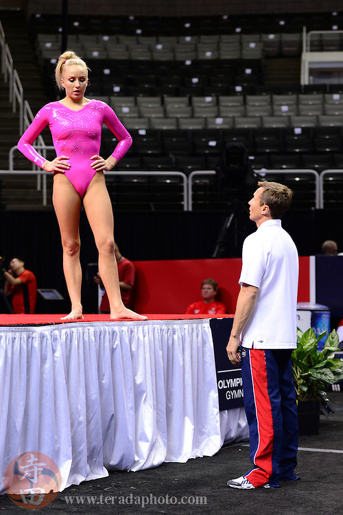 June 29, 2012; San Jose, CA, USA; Nastia Liukin (left) talks to coach Valeri Liukin (right) while warming up on the balance beam during the 2012 USA Gymnastics Olympic Team Trials at HP Pavilion.