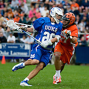 DURHAM, N.C.--Duke senior attackman Ned Crotty turned in a career day to lead the eighth-ranked Blue Devils to a thrilling 15-10 victory over top-ranked and unbeaten Virginia in front of a capacity crowd for men's lacrosse at Koskinen Stadium. Crotty tallied a career-high eight points from two goals and a career-high six assists to lead all scorers in the contest.