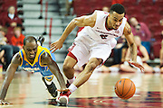 FAYETTEVILLE, AR - NOVEMBER 13:  Jabril Durham #4 of the Arkansas Razorbacks goes after a loose ball against Adrian Rodgers #2 of the Southern University Jaguars at Bud Walton Arena on November 13, 2015 in Fayetteville, Arkansas.  The Razorbacks defeated the Jaguars 86-68.  (Photo by Wesley Hitt/Getty Images) *** Local Caption *** Jabril Durham; Adrian Rodgers