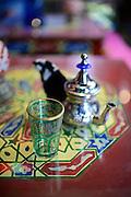 Tea glass and jar on table at tea house, Granada, Spain