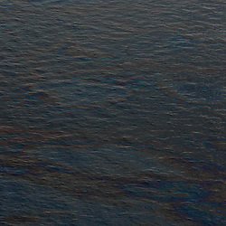 Oil is seen on the surface of the water near at the site of the BP Plc Deep Water Horizon oil spill in the Gulf of Mexico off the coast of Louisiana, U.S., on Saturday, June 19, 2010.  (Mandatory Credit: Derick E. Hingle)