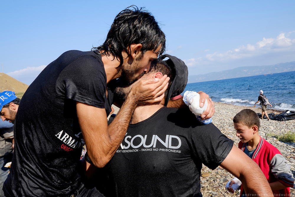 Refugees who arrive safely, often hug and kiss eachother.<br /> Refugees arriving on beaches near Molyvos village in Lesvos island. Thousands of them come from Turkey, crossing the sea border on inflatable dinghy boats, on a dangerous trip that has claimed many lives. Local people or NGOs expect them and help them in some places but after their arrival, most of them have to walk to the nearest village where they can hope for a places on busses that can take them to the city of Mytilene where they can register and eventually board on a ferry to Athens. Many decide to walk the distance as the busses aren&rsquo;t enough to accommodate the large number of people that arrive daily.