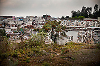 The colony of La Verbena merges with the cemetery, in Zone 7, Guatemala City, on Thursday, April 12, 2012.