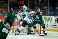 KELOWNA, CANADA - JANUARY 9:  Reece Vitelli #26 of the Everett Silvertips is checked by Devin Steffler #4 in front of the net of James Porter #1 of the Kelowna Rockets during first period on January 9, 2019 at Prospera Place in Kelowna, British Columbia, Canada.  (Photo by Marissa Baecker/Shoot the Breeze)
