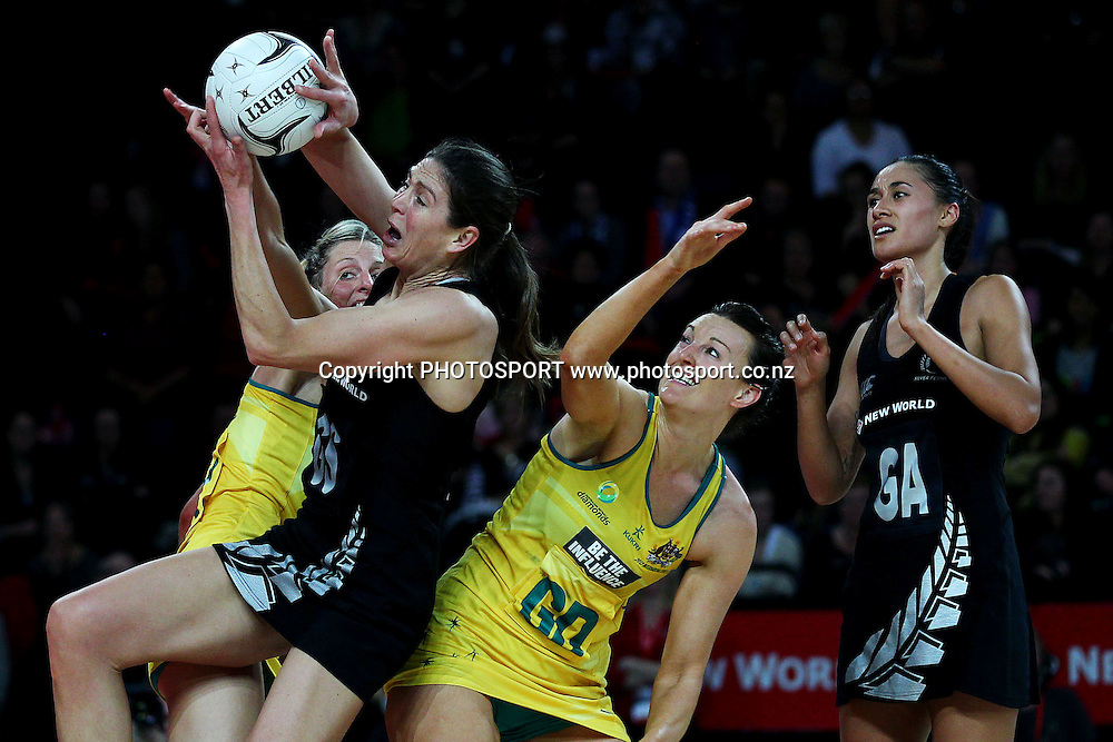 Irene van Dyk of New Zealand competes for a rebound against Laura Geitz and Bianca Chatfield of Australia. International Netball Series, Constellation Cup Test Match, New Zealand Silver Ferns v Australian Diamonds at Vector Arena, Auckland, New Zealand. Thursday 19th September 2013. Photo: Anthony Au-Yeung / photosport.co.nz