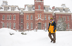 Saturday, Jan. 22, 2016: West Virginia University college students walk on campus in Morgantown, W.Va. after Winter Storm Jonas ripped through North Central West Virginia and dumped nearly 18 inches of snow. (Photo by Ben Queen)