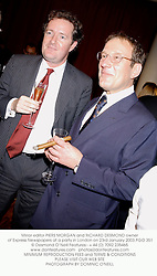 Mirror editor PIERS MORGAN and RICHARD DESMOND owner of Express Newspapers at a party in London on 23rd January 2003.	PGO 351